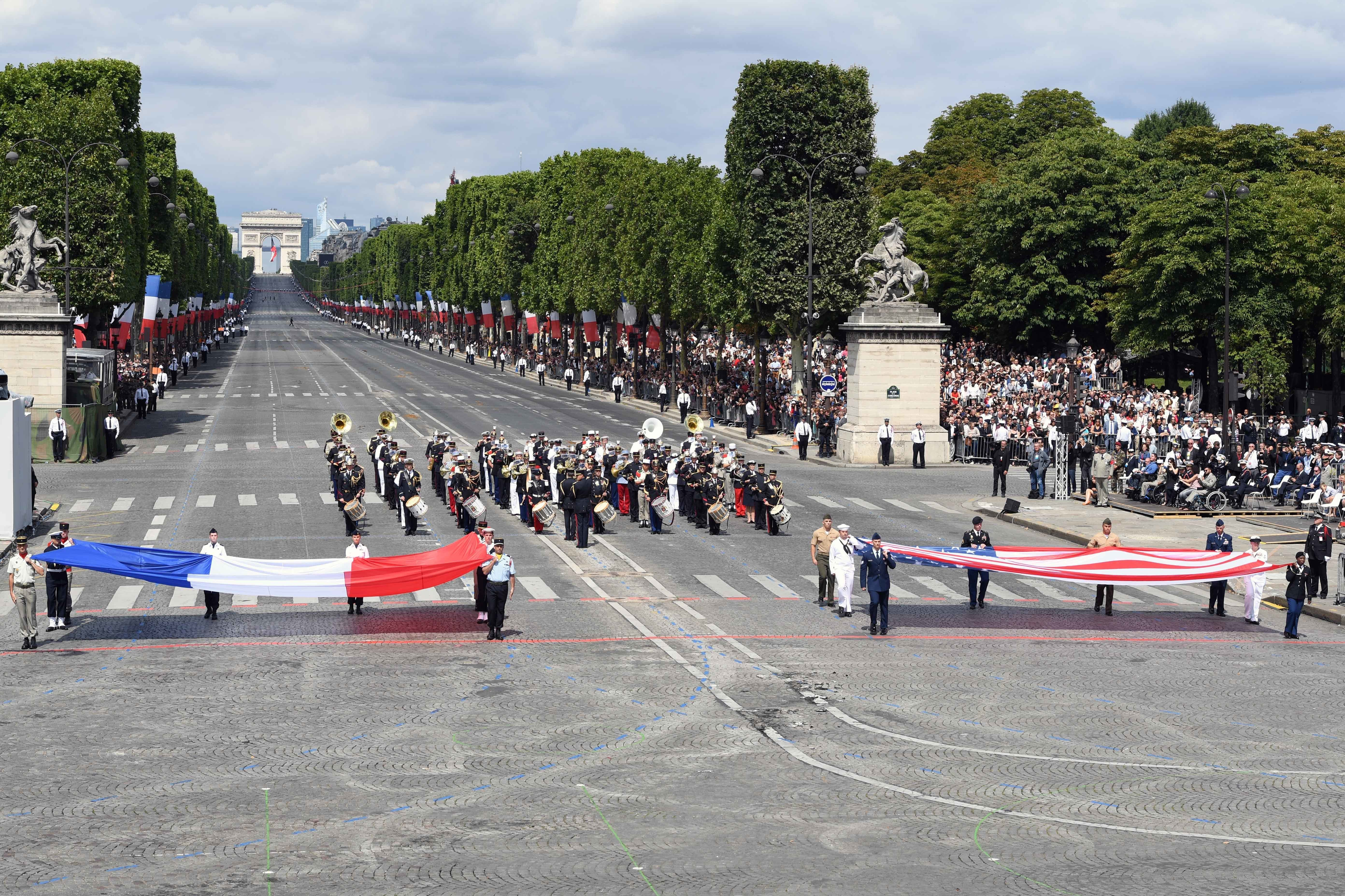170714-N-AC979-495 PARIS (July 14, 2017) U.S. and French service members display each country's respective flag during the Military Parade on Bastille Day. An historic first, the U.S. led the parade as the country of honor this year in commemoration of the centennial of U.S. entry into World War I and the long-standing partnership between France and the U.S. (U.S. Navy photo by Chief Mass Communication Specialist Michael McNabb/Released)