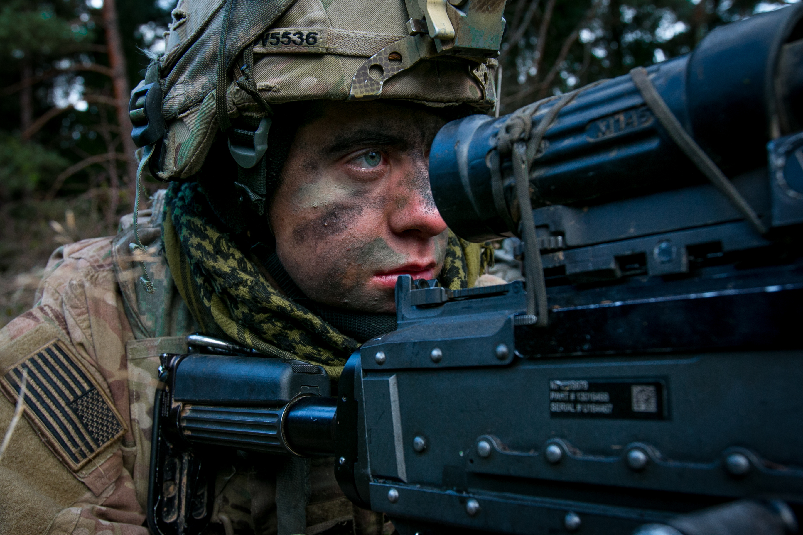 A Soldier assigned to 2nd Battalion, 70th Armor Regiment, 2nd Armored Brigade Combat Team, 1st Infantry Division from Fort Riley, Kansas scans the terrain over the sights of his M-249 machine gun Nov. 18, 2017 during an Allied Spirit VII training event in Grafenwoehr, Germany. The U.S. Army, along with its allies and partners, continues to forge a dynamic presence with a powerful land network that simultaneously deters aggression and assures the security of the region. Approximately 3,700 service members from 13 nations gathered in 7th Army Training Command's Hohenfels Training Area in southeastern Germany to participate in the seventh iteration of Allied Spirit which is scheduled for Oct. 30 - Nov. 22, 2017. (U.S. Army photo by Spc. Dustin D. Biven / 22nd Mobile Public Affairs Detachment)