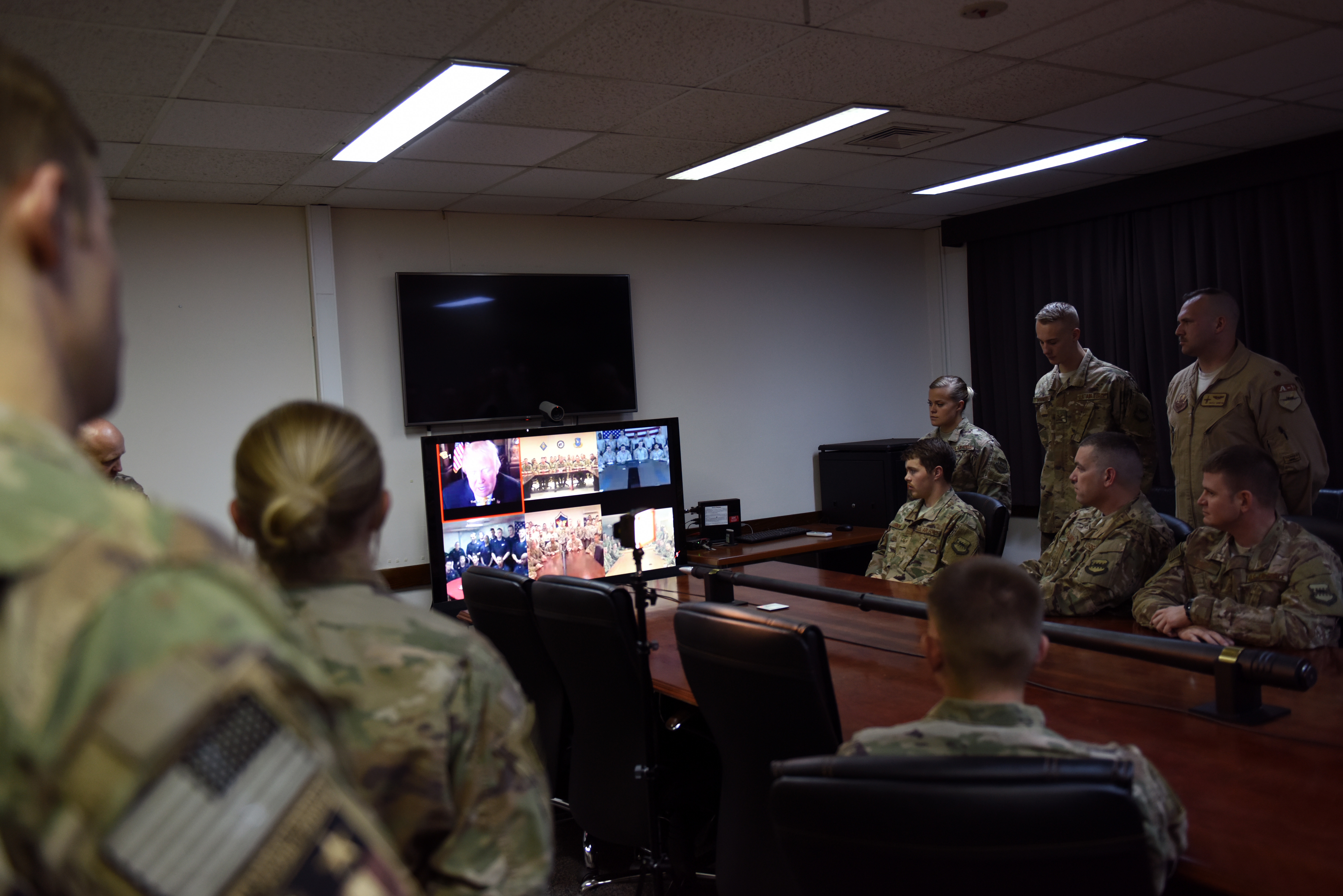 Airmen from the 74th Expeditionary Fighter Squadron, talk to President Donald Trump at Incirlik Air Base, Turkey, Nov. 23, 2017. The 74th EFS was one of five deployed military units, one representing each branch of the military, chosen to receive the traditional Thanksgiving call from the President. This years marks the first time the President conducted a video teleconference call with deployed personnel in lieu of the traditional telephone call. (U.S. Air Force photo by Staff Sgt. Jason Huddleston)