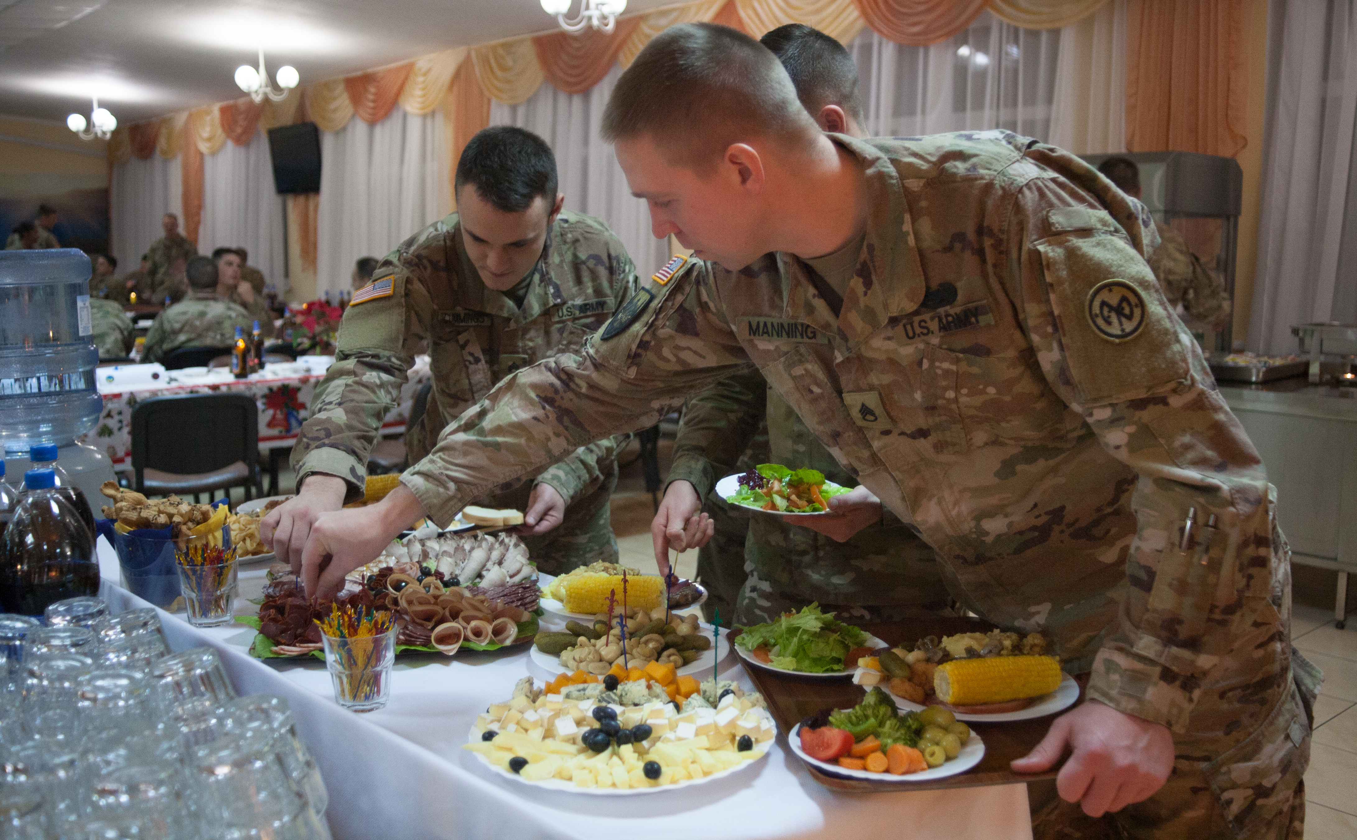 Yavoriv, Ukraine – 27th Infantry Brigade Combat Team Soldiers assigned to the Joint Multinational Training Group – Ukraine host a Christmas dinner at the Yavoriv Combat Training Center near Yavoriv, Ukraine. Currently more than 220 of the Brigade's Soldiers are deployed overseas working alongside the Ukrainian Army. (U.S. Army photo by Sgt. Alexander Rector)