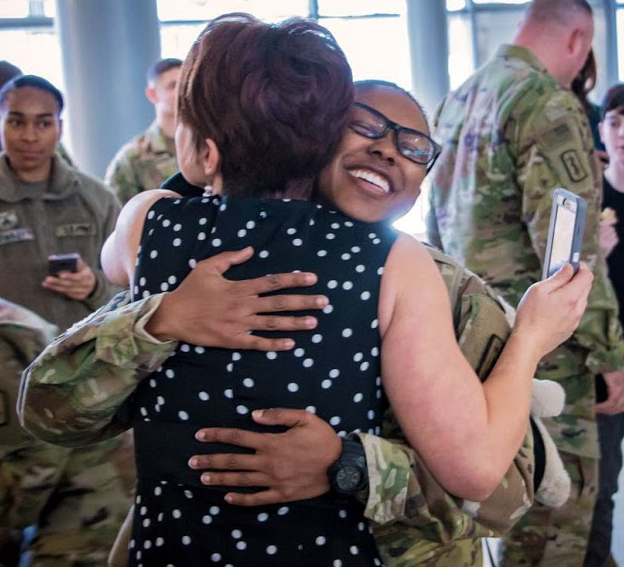 Capt. Melissa Coker embraces Megan Nunez during the redeployment ceremony for 254th Medical Detachment, Jan. 11 at Ramstein Air Base in Kaiserslautern, Germany. The combat operational stress control unit completed a 9-month deployment to Central Command area of responsibility.