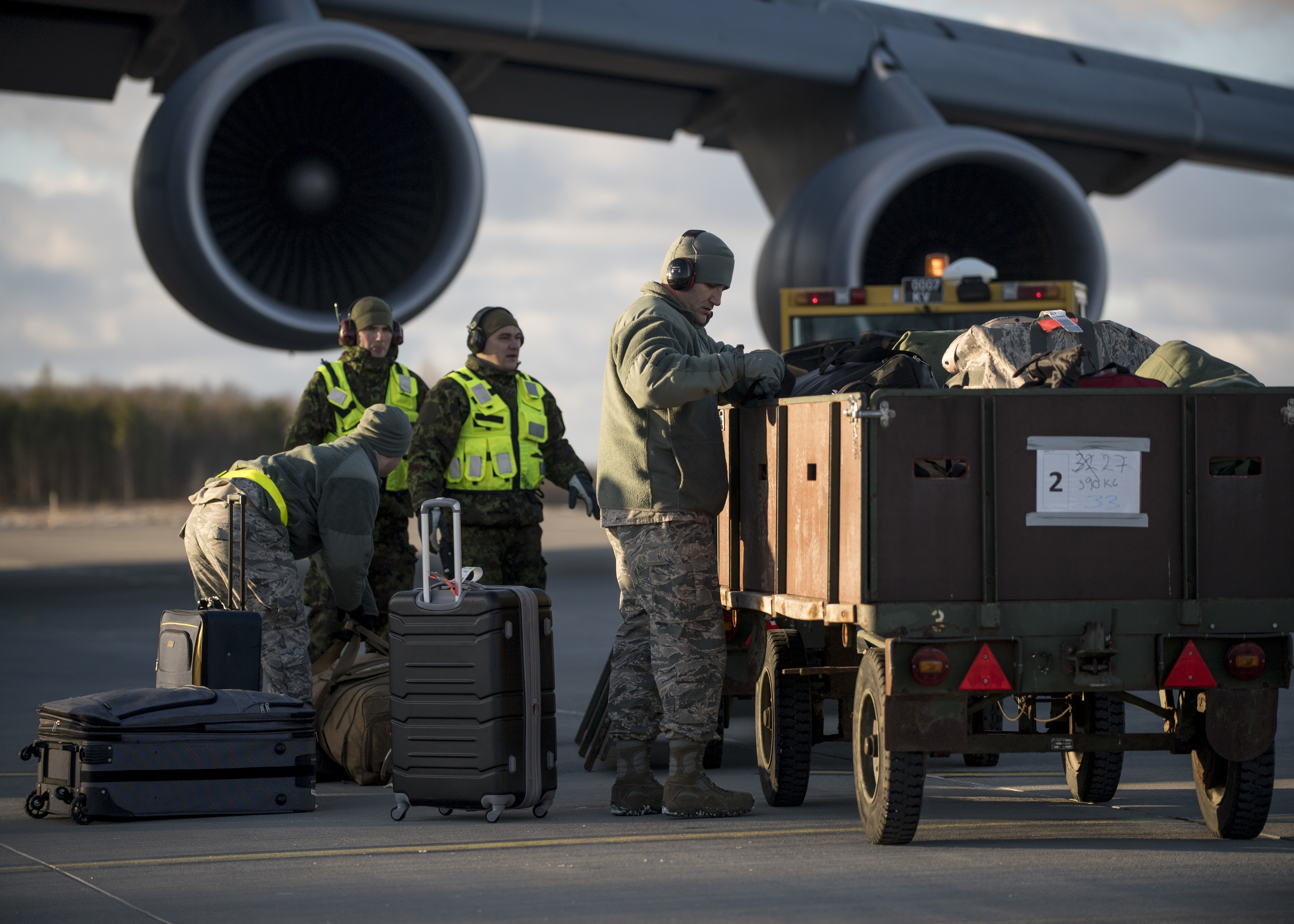 U.S. and Estonian airmen work together to unload supplies from a C-5 Galaxy cargo plane in support of Theater Security Package 18.1, Jan. 8, 2018. This TSP highlights the U.S.'s ability to deploy fighter aircraft in support of our partners and allies in the European theater and around the world. (DoD photo by MC3 Cody Hendri)