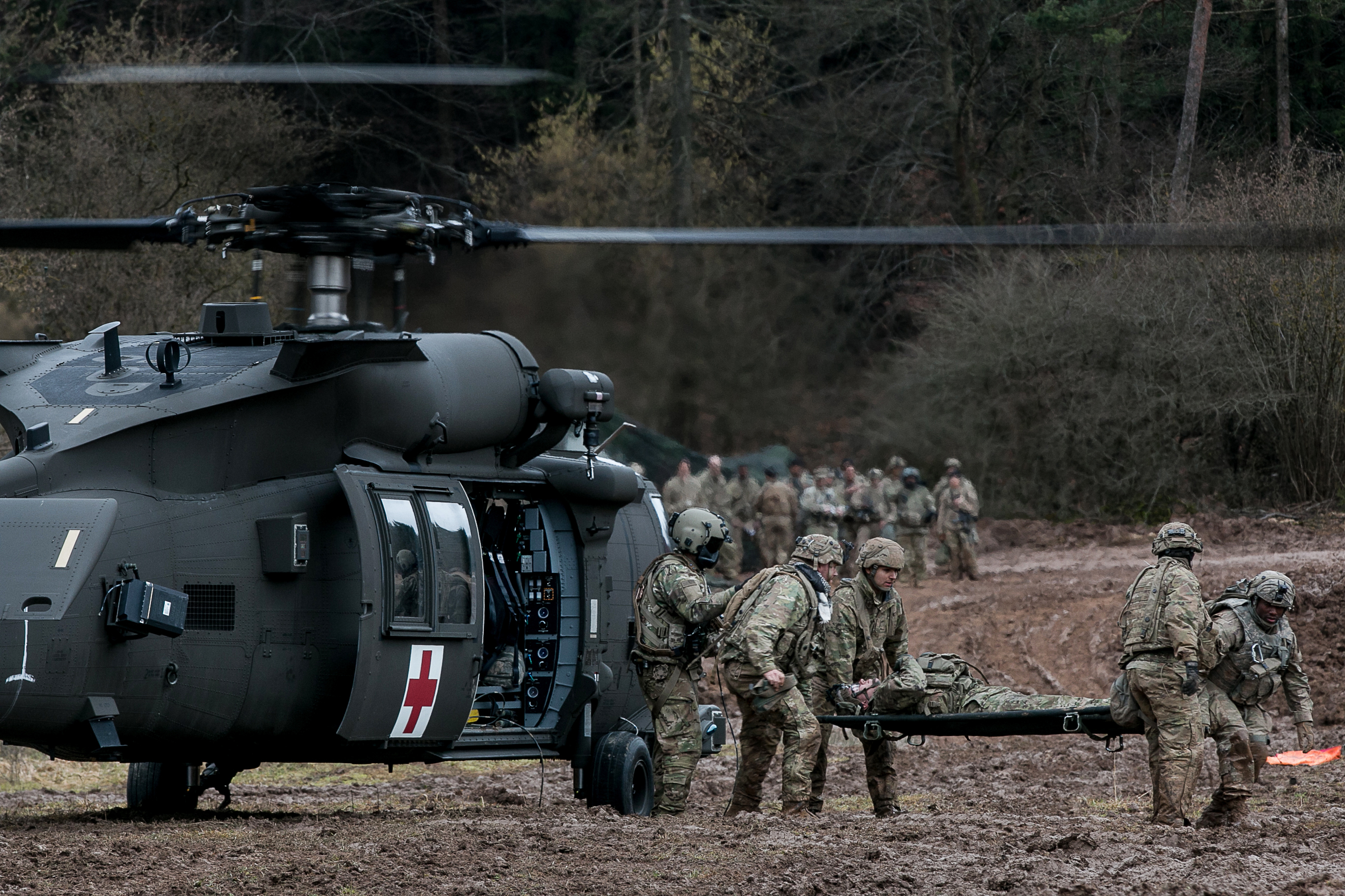 Medics from 557th Medical Company, 421st Medical Battalion, 30th Medical Brigade, Baumholder, Germany, conduct rapid medical evacuation training Jan. 29, 2018 during Allied Spirit VIII at Hohenfels Training Area, Germany. Roughly 4,100 troops from 10 nations are participating in Allied Spirit VIII, a multinational training exercise designed to test participants' readiness and capabilities. (U.S. Army photo by Spc. Dustin D. Biven / 22nd Mobile Public Affairs Detachment)