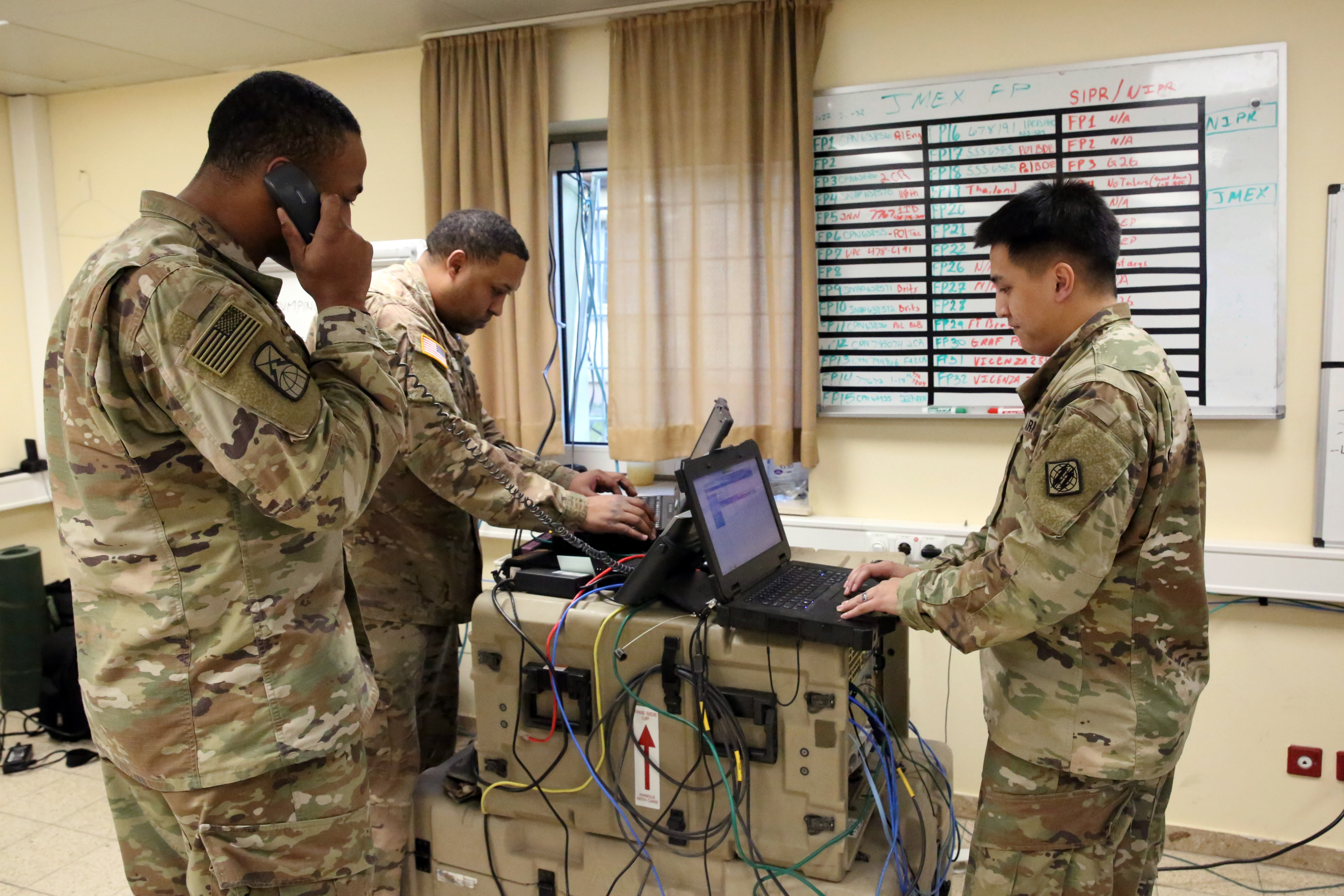 U.S. Army 1st Lt. Shaun Lawson, Cpl. Marvin Carson and Sgt. John Delgado, assigned to Charlie Company, 44th Expeditionary Signal Battalion, 2nd Theater Signal Brigade, manage the company network operations (NETOPS) cell monitoring the networks at exercise Allied Spirit VIII, Jan. 30, 2018 at the Hohenfels Training Area, Germany. (U.S. Army photo by William B. King)