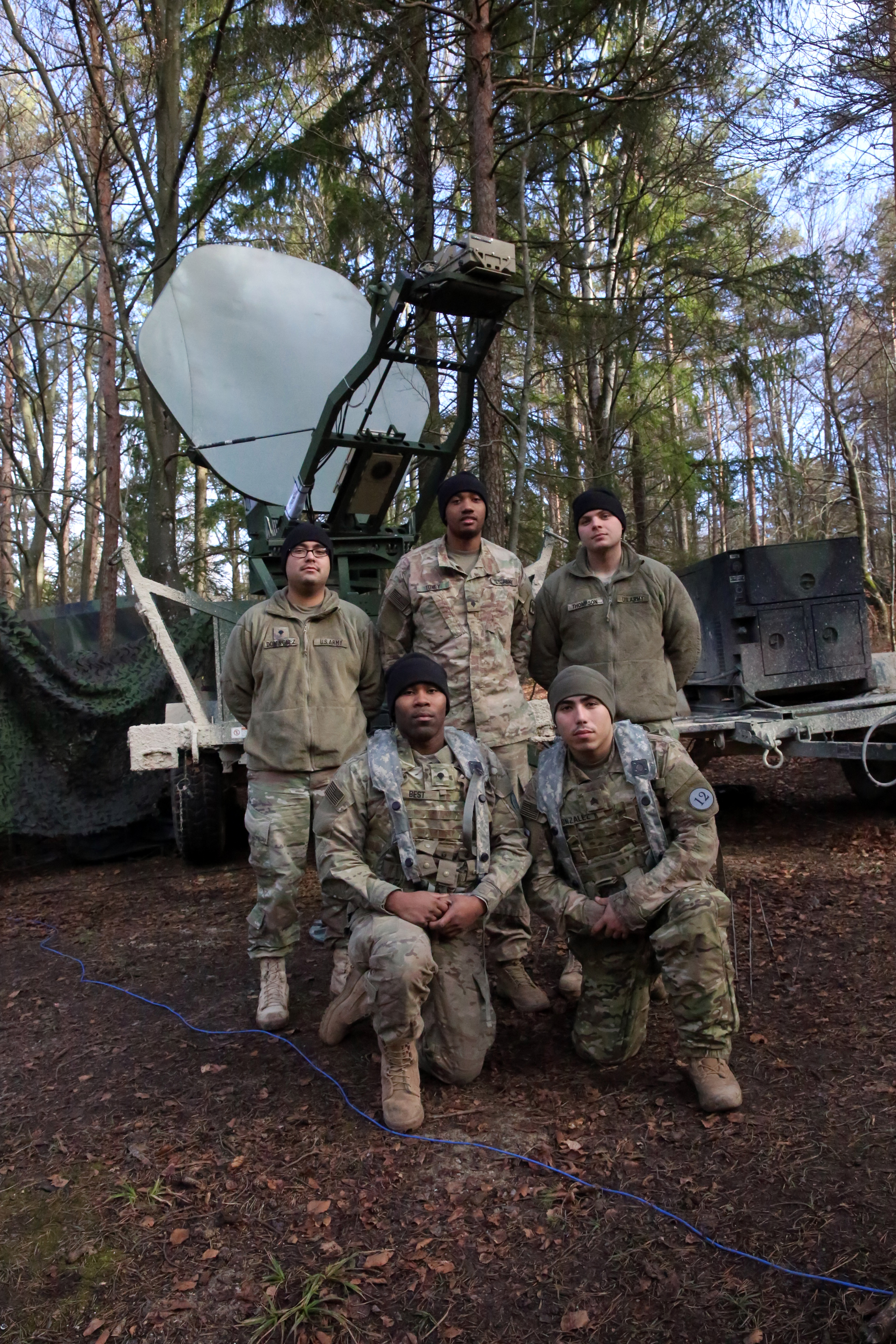 U.S. Army Soldiers assigned to Charlie Company, 44th Expeditionary Signal Battalion, 2nd Theater Signal Brigade, pose for a picture during exercise Allied Spirit VIII, Jan. 31, 2018 in the Hohenfels Training Area, Germany. The Soldiers operate a command post node providing communications and network support to Poland's 12th Mechanized Brigade, the multinational brigade headquarters for the exercise. (U.S. Army photo by William B. King)