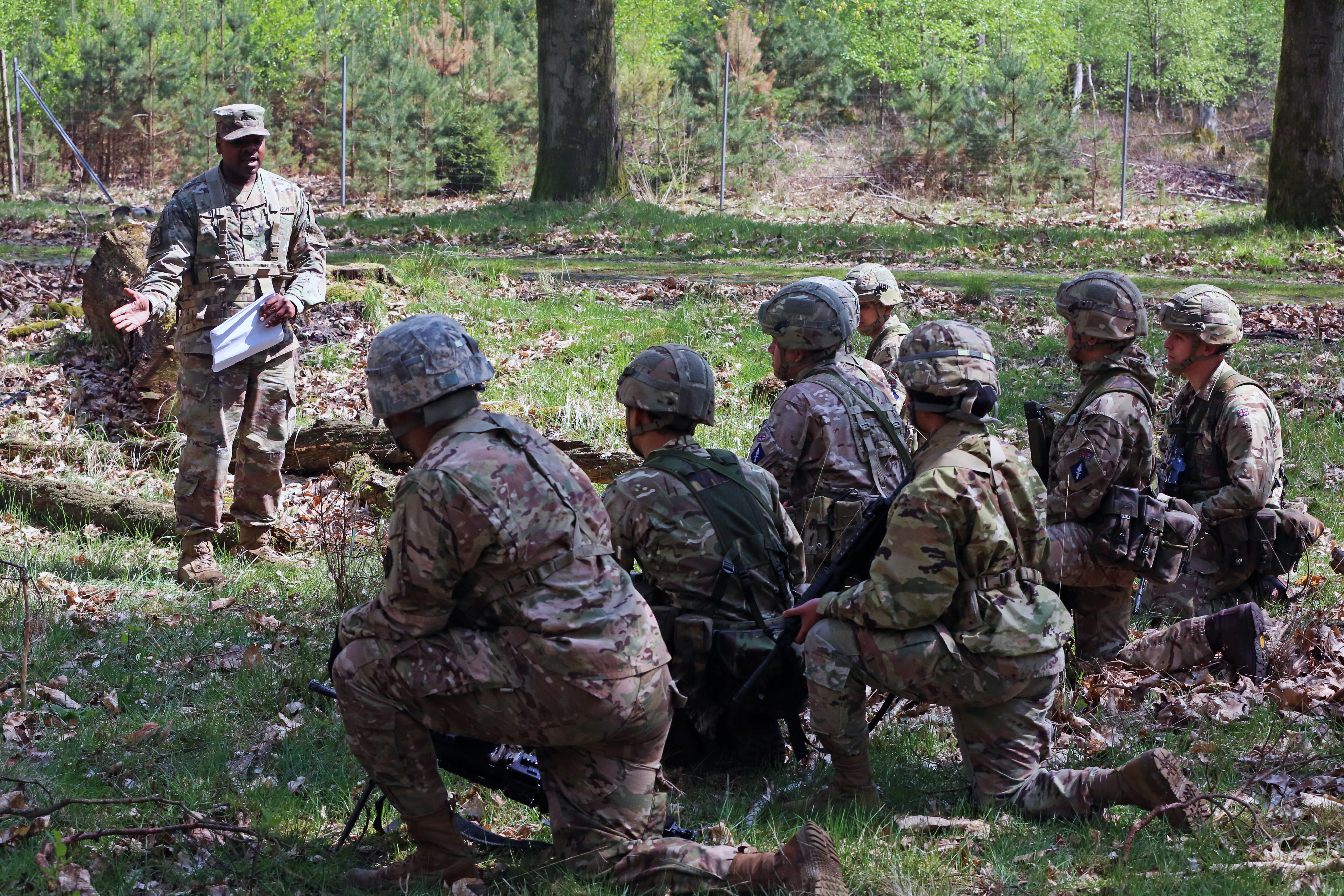 U.S. Army Sgt. Aaron Ward, assigned to Bravo Company, 44th Expeditionary Signal Battalion, 2nd Theater Signal Brigade, instructs U.S. and British Army Soldiers assigned to the 250th Signal Squadron, Queen's Gurkha Signals, on react to contact battle drill during exercise Stoney Run, April 23, 2018 in the Sennelager Training Area, Germany. Stoney Run is an annual U.S.-U.K. signal exercise designed to test and validate communications and network capabilities, and enhance interoperability and partner capacity between the two NATO allies. (U.S. Army photo by William B. King)