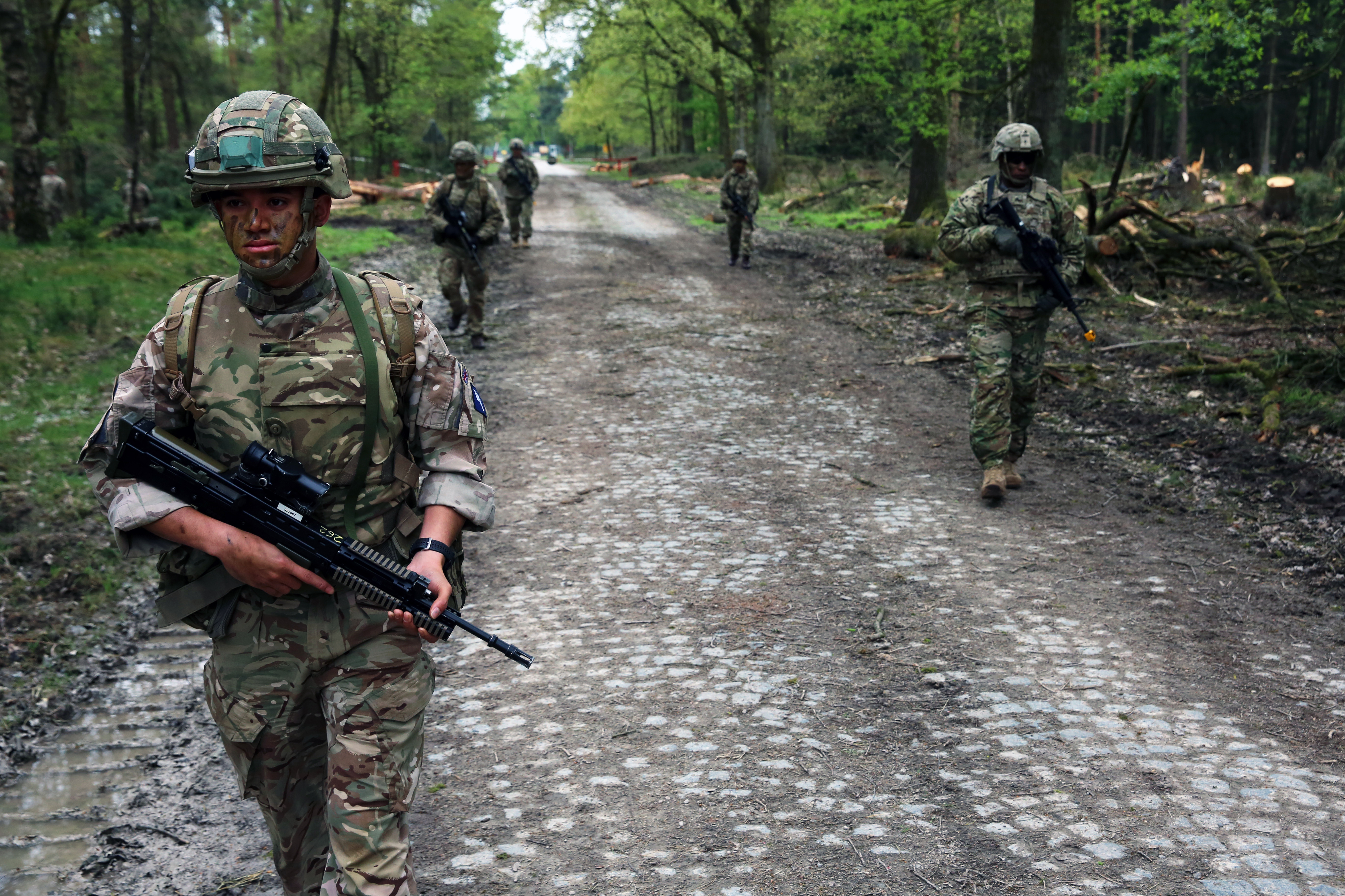 U.S. Army Soldiers assigned to Bravo Company, 44th Expeditionary Signal Battalion, 2nd Theater Signal Brigade, and British Army Soldiers assigned to the 250th Signal Squadron, Queen's Gurkha Signals, conduct a joint tactical patrol during exercise Stoney Run, April 24, 2018 in the Sennelager Training Area, Germany. Stoney Run is an annual U.S.-U.K. signal exercise designed to test and validate communications and network capabilities, and enhance interoperability and partner capacity between the two NATO allies. (U.S. Army photo by William B. King)