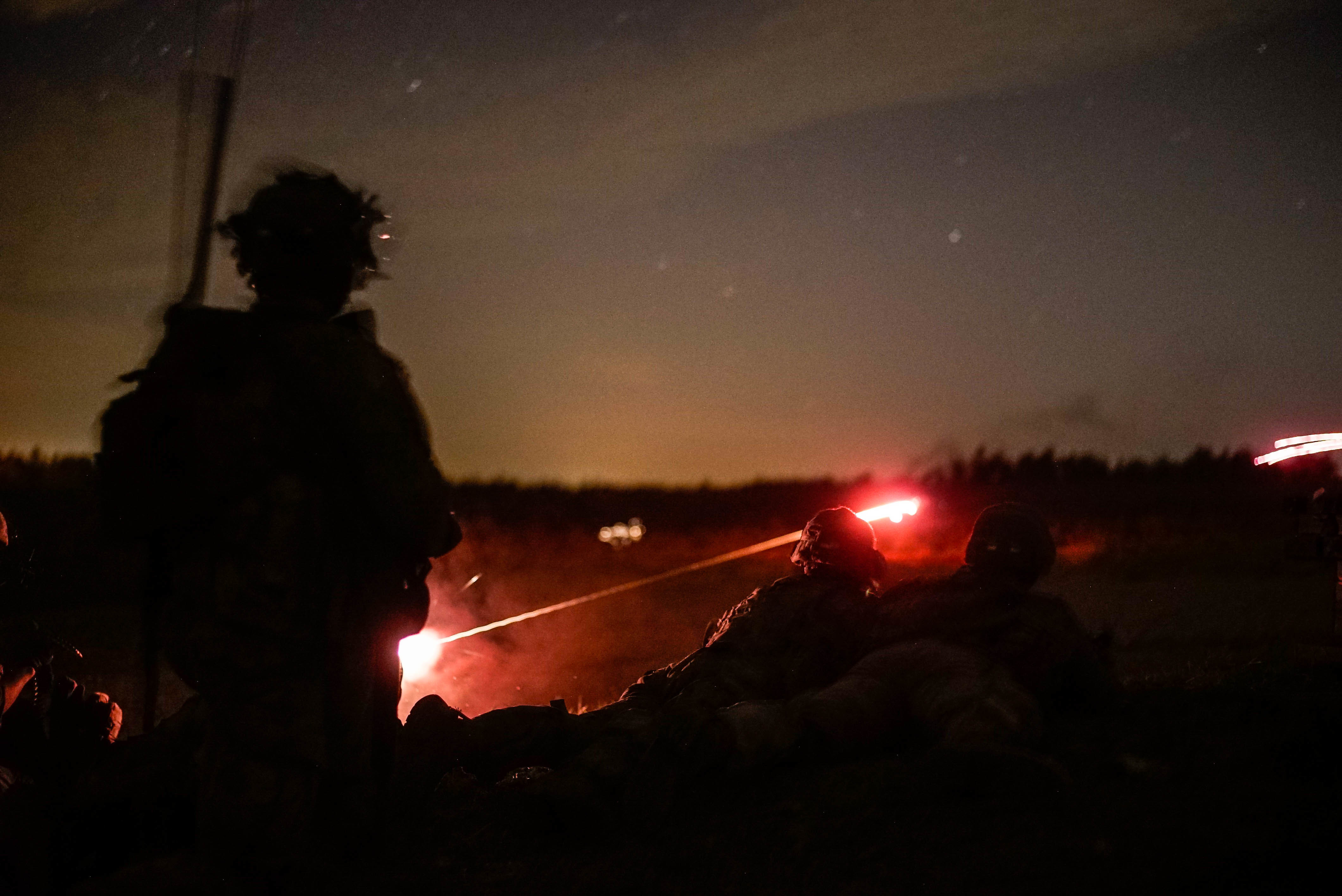 U.S. Army paratroopers with the 1st Battalion, 503rd Infantry Regiment, 173rd Airborne Brigade fire down range during a night exercise at the 7th Army Training Command's Grafenwoehr Training Area, Germany, May 2, 2018. Exercise Eagle Fury is a combined arms live fire exercise that tests day and night live fire capabilities across multiple military specialties. (U.S. Army photo by Spc. Elliott Banks)