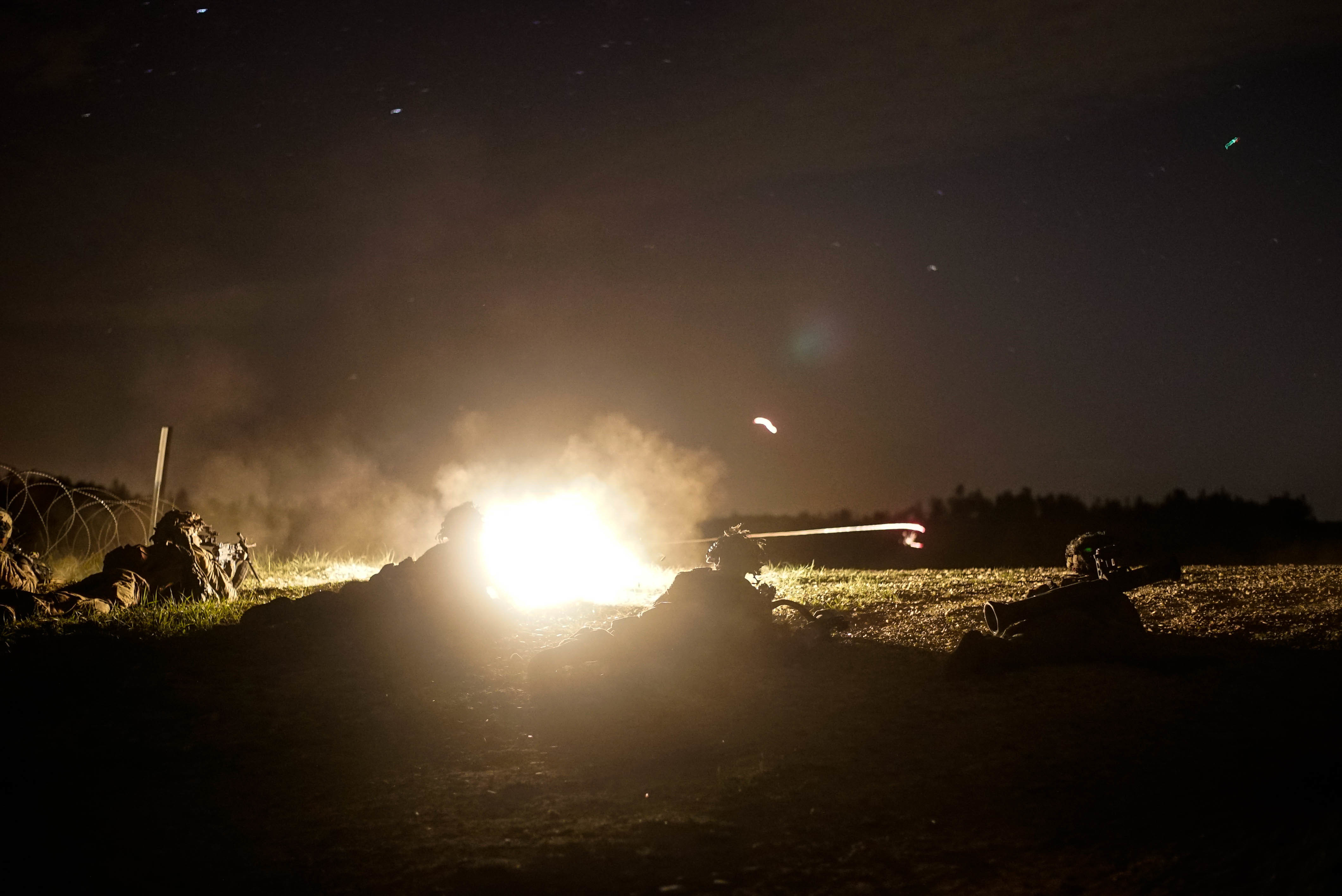 U.S. Army Paratroopers with the 1st Battalion, 503rd Infantry Regiment, 173rd Airborne Brigade fire down range during a night exercise at the 7th Army Training Command's Grafenwoehr Training Area, Germany, May. 2, 2018. Exercise Fury is a combined arms live fire exercise that tests day and night live fire capabilities across multiple military specialties. (U.S. Army Photo by Spc. Elliott Banks)