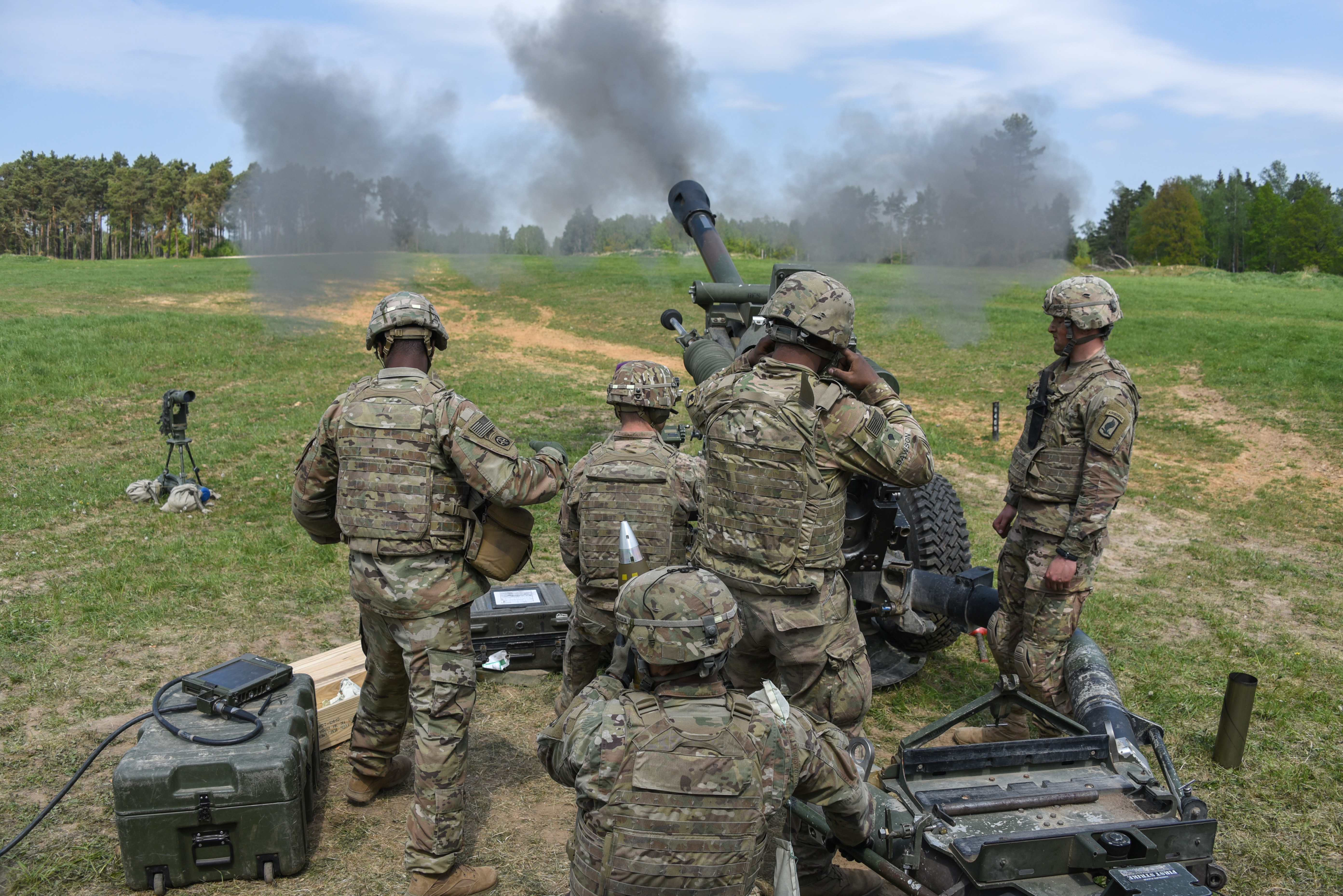 U.S. Army Paratroopers, assigned to Battery A, 4th Battalion, 319th Airborne Field Artillery Regiment, 173rd Airborne Brigade, fire a M119 105mm howitzer during a live fire exercise at the 7th Army Training Command's Grafenwoehr Training Area, Germany, May 4, 2018. (U.S. Army photo by Markus Rauchenberger)