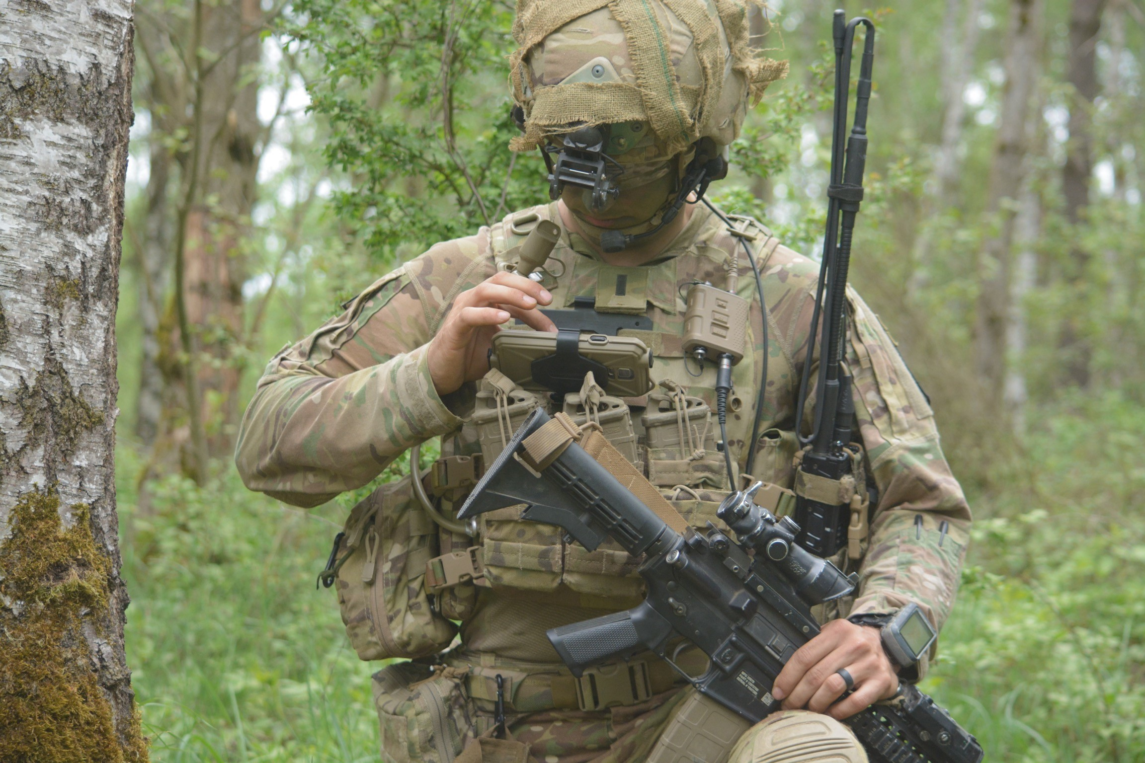 1st. Lt. Michael Austin, platoon leader for Attack Co., 1-503rd Inf. Regt., 173rd Airborne Brigade, uses the End User Device to report information to his company commander through the Integrated Tactical Network during a live-fire exercise in Grafenwoehr, Germany, May 02.