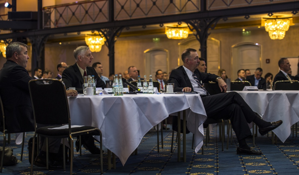Members of the Joint U.S. European Command/U.S. Africa Command Deployment and Distribution Conference listen to a presentation, at the Maritim Hotel in Stuttgart, Germany. The JEADDC took place May 21–23, with over 200 people in attendance to discuss the importance of logistics within their respective theaters.