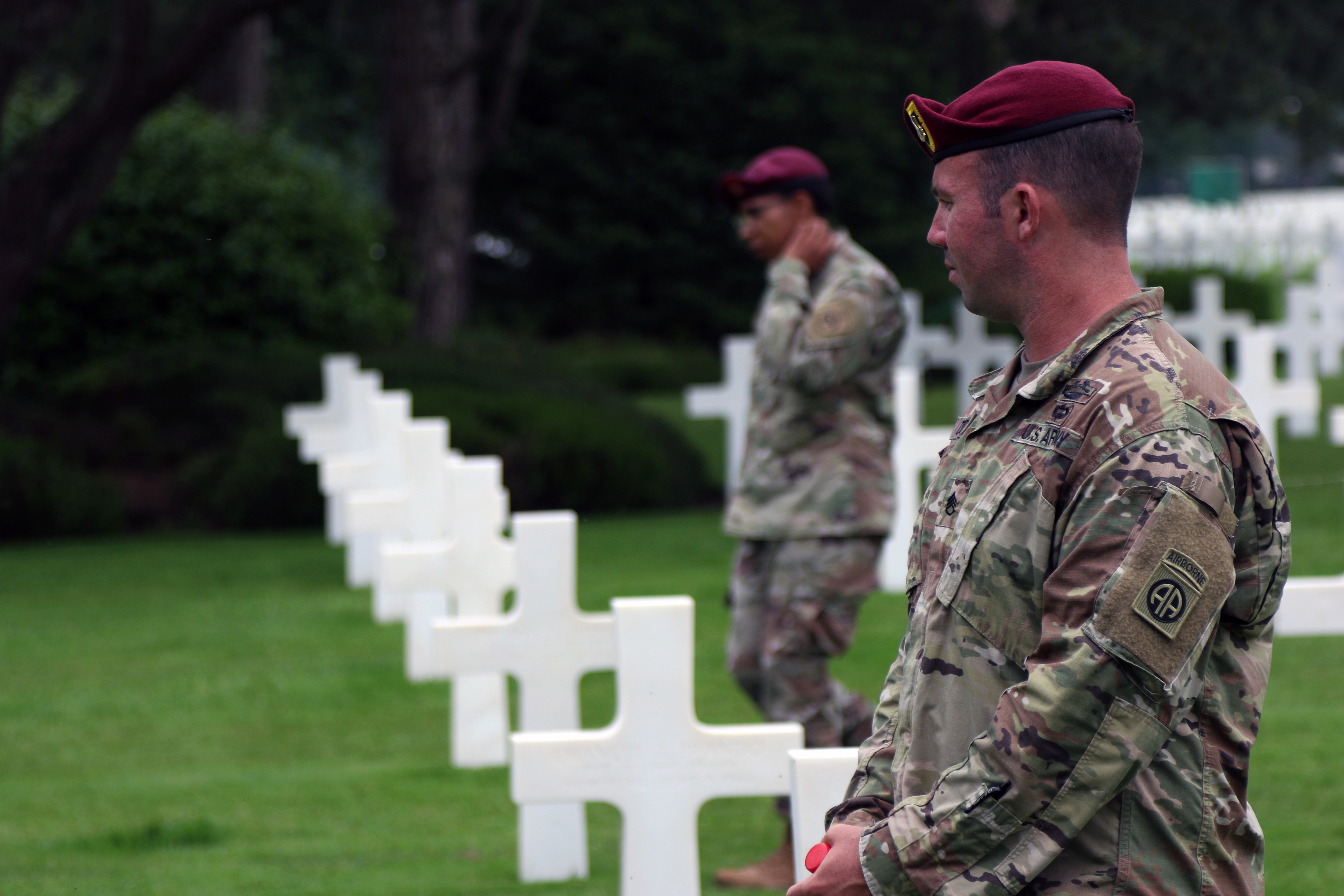 Staff Sgt. Kyle Dodier (front), a weapons squad leader with Co. B., 2nd Battalion 504th Parachute Infantry Regiment, 1st Brigade Combat Team, 82nd Airborne Division, walks among the tombstones at the Normandy American Cemetery and Memorial during a staff ride on May 31, at Normandy, France. Dodier and dozens of other division paratroopers are in Normandy to participate in the 74th D-Day commemoration and ceremonies.