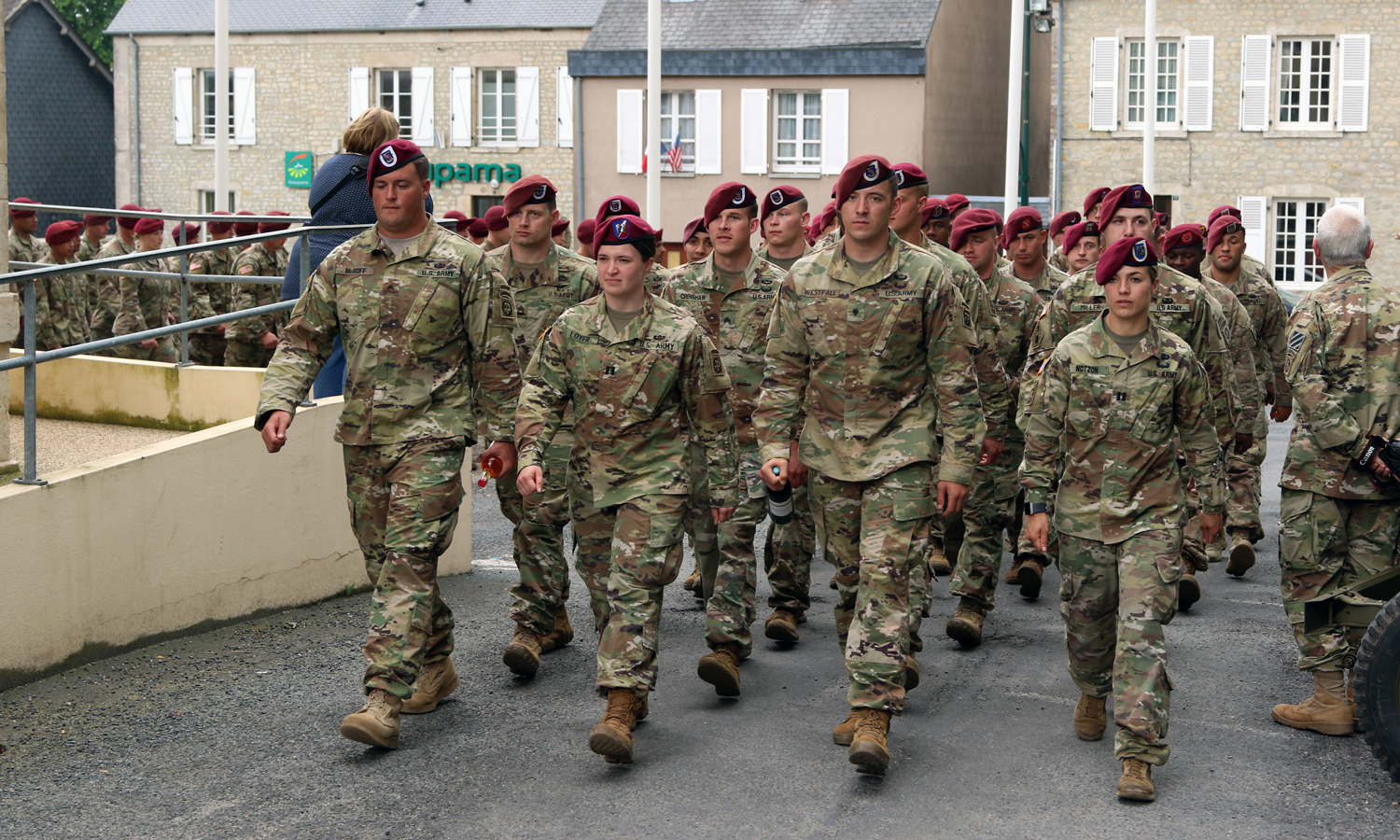 82nd Airborne Division paratroopers and Soldiers of other units, that fought during WWII, march to the Sainte Mere Eglise town hall on May 31, at Normandy, France. Local Families hosted the paratroopers for dinner to show their appreciation for the paratroopers and servicemembers that fought back the Nazis during WWII.