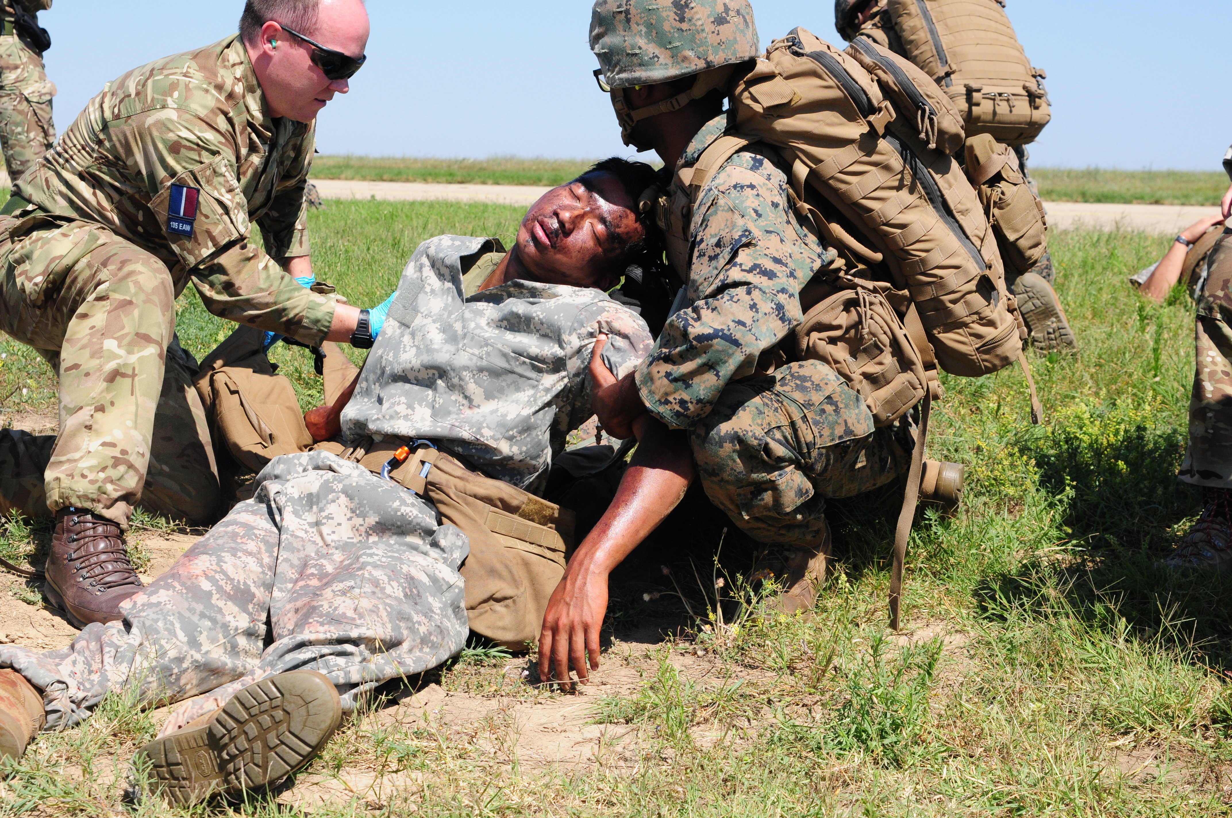 U.S. Marine and British medics quickly administer aid to simulated casualties and complete the nine-line medevac at Mihail Kogalniceanu Air Base in Romania, August 16, 2018. The U.S. Air Force, U.S. Marine Corps and British soldiers conducted Exercise Black Lion and Caduceus in support of Atlantic Resolve, an enduring training exercise between NATO and U.S. Forces.