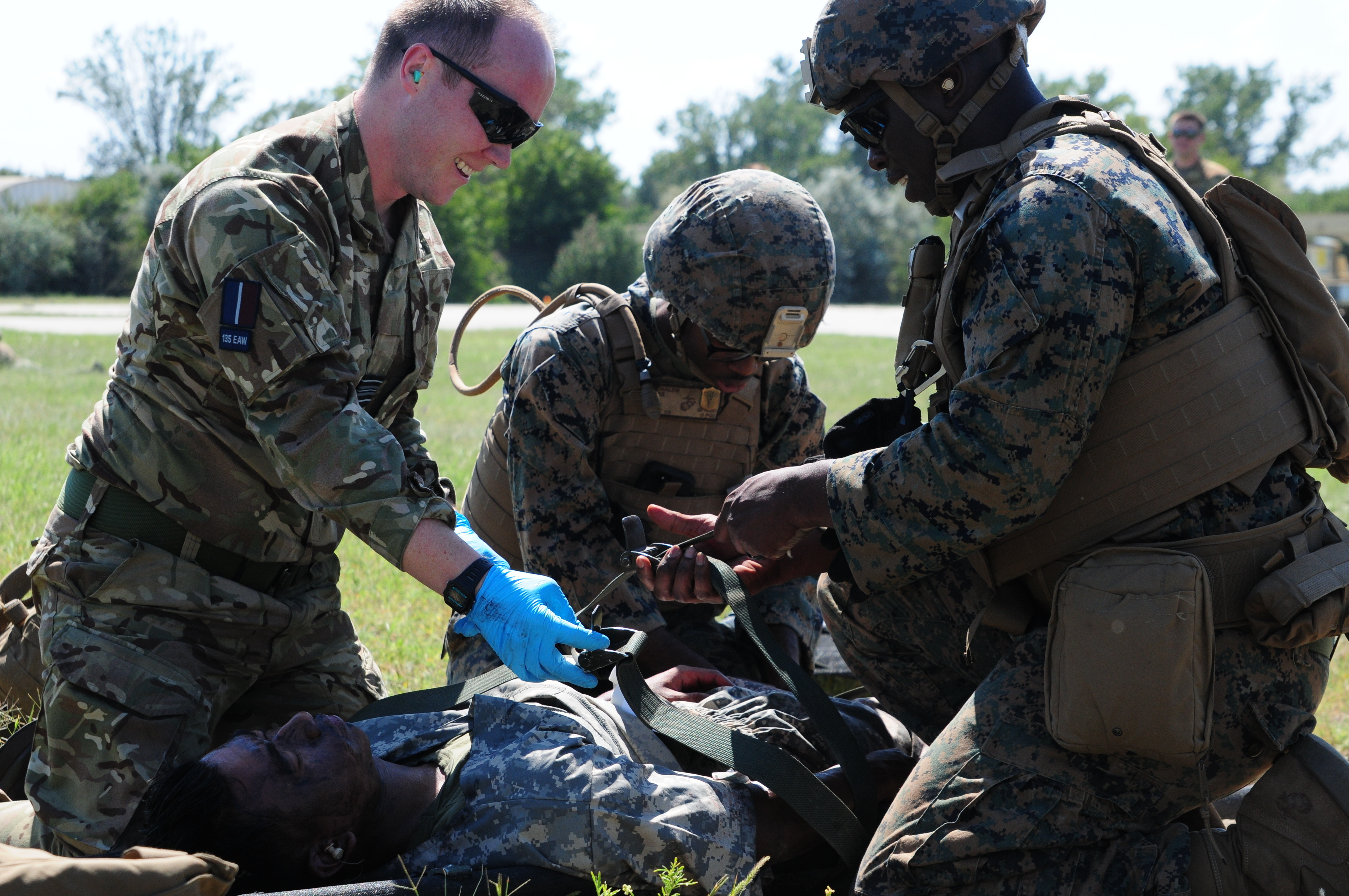 U.S. Marine and British medics quickly administer aid to simulated casualties and complete the 9-line medevac at Mihail Kogalniceanu Air Base in Romania, August 16, 2018. The U.S. Air Force, U.S. Marine Corps and British soldiers conducted Exercise Black Lion and Caduceus in support of Atlantic Resolve, an enduring training exercise between NATO and U.S. Forces.