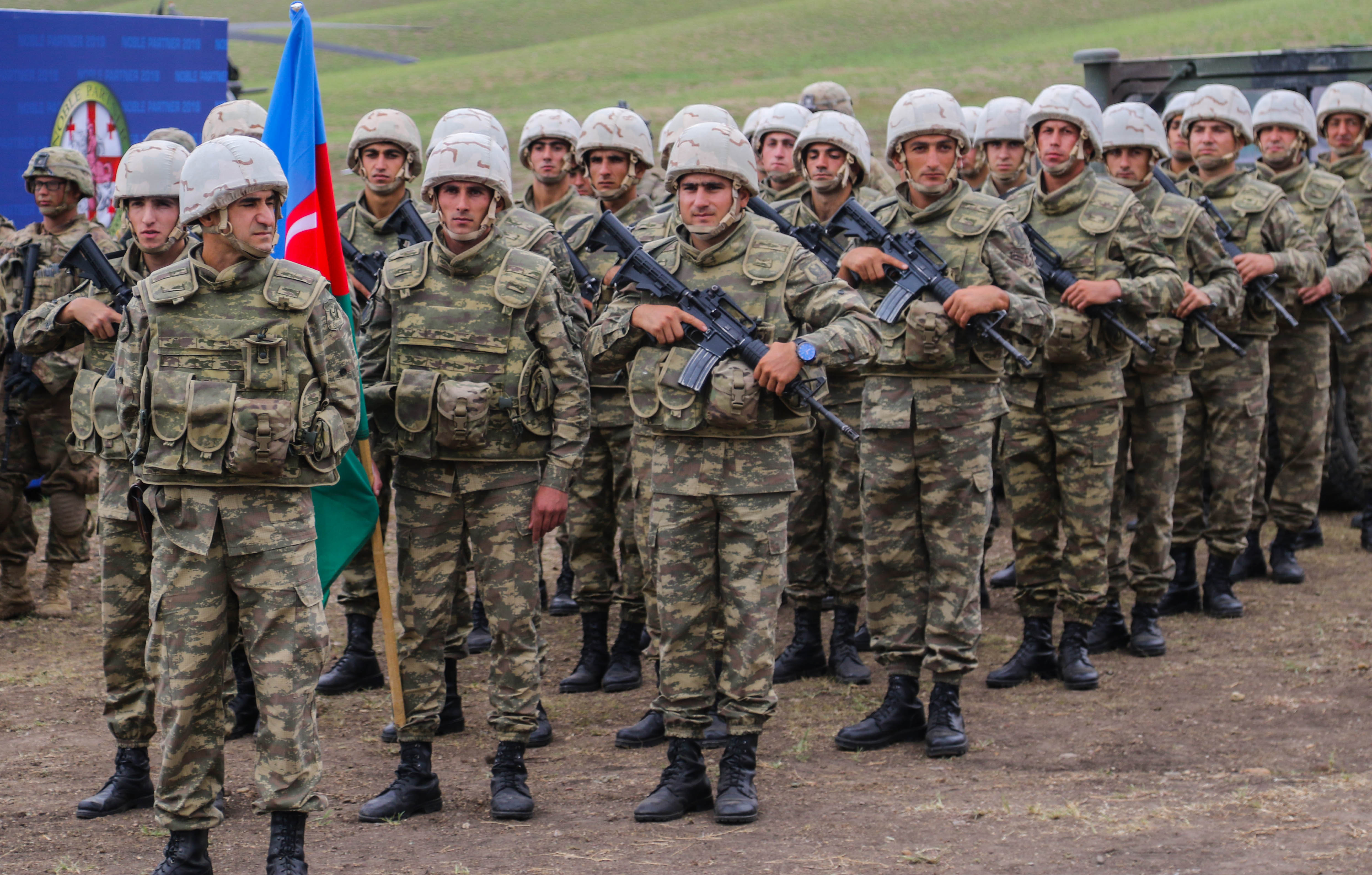 Azerbaijani army soldiers participate in the closing ceremony for Noble Partner 18 at Vaziani Training Area, Georgia, Aug. 15, 2018. Noble Partner 18 was a cooperatively-led multinational training exercise in its fourth iteration which supported the training of Georgian Armed Forces' mechanized and Special Operation Forces, U.S. Regionally Aligned Forces, the U.S. Army and Air National Guard from the state of Georgia, and 11 other participating nations. (U.S. Army photo by Sgt. Kris Bonet)