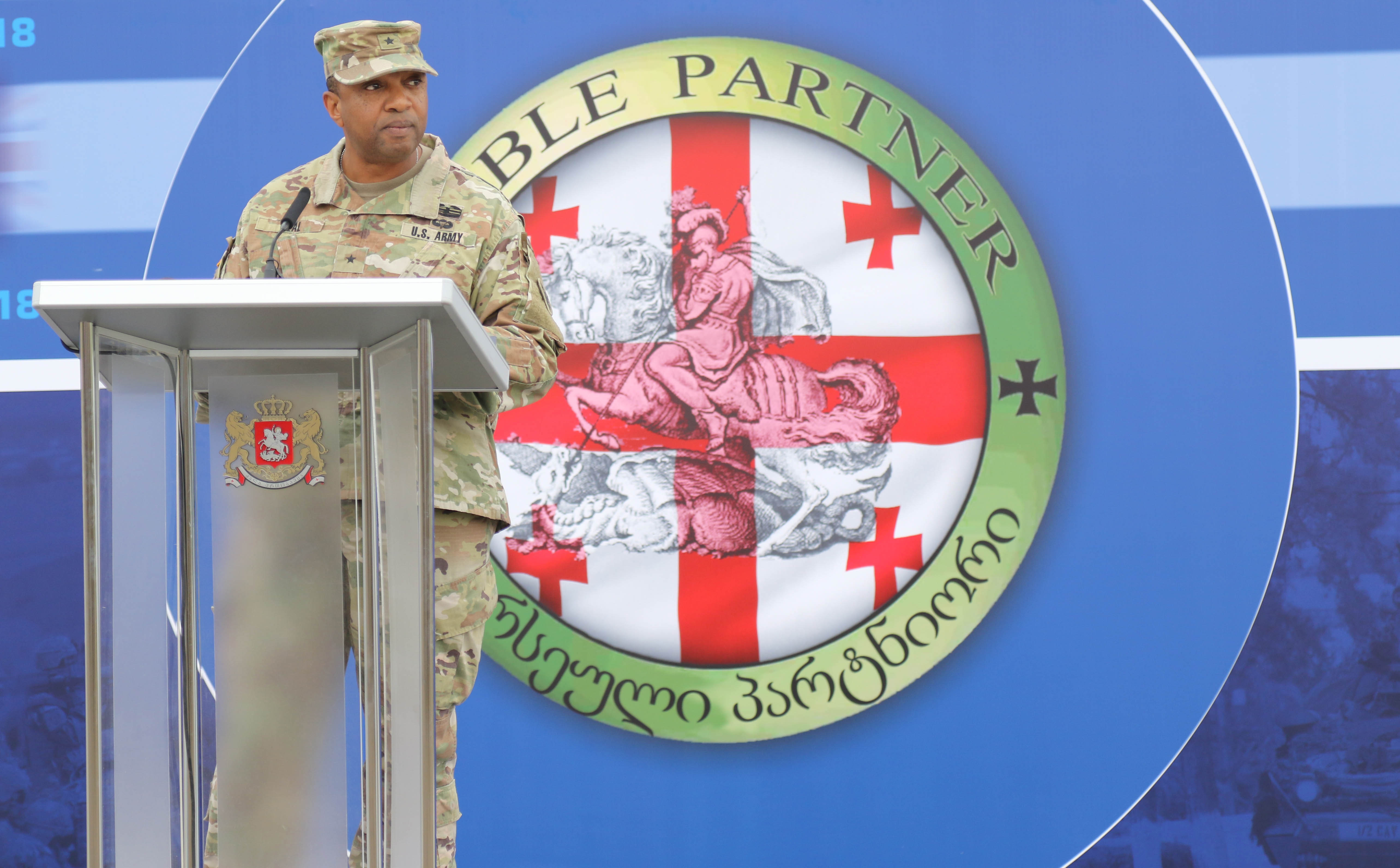 Brig. Gen. Reginald Neal, Director of the Joint Staff for the Georgia National Guard, makes his remarks during the closing ceremony for Noble Partner 18 at Vaziani Training Area, Georgia, Aug. 15, 2018. Noble Partner 18 was a cooperatively-led multinational training exercise in its fourth iteration which supported the training of Georgian Armed Forces' mechanized and Special Operation Forces, U.S. Regionally Aligned Forces, the U.S. Army and Air National Guard from the state of Georgia, and 11 other participating nations. (U.S. Army photo by Sgt. Kris Bonet)