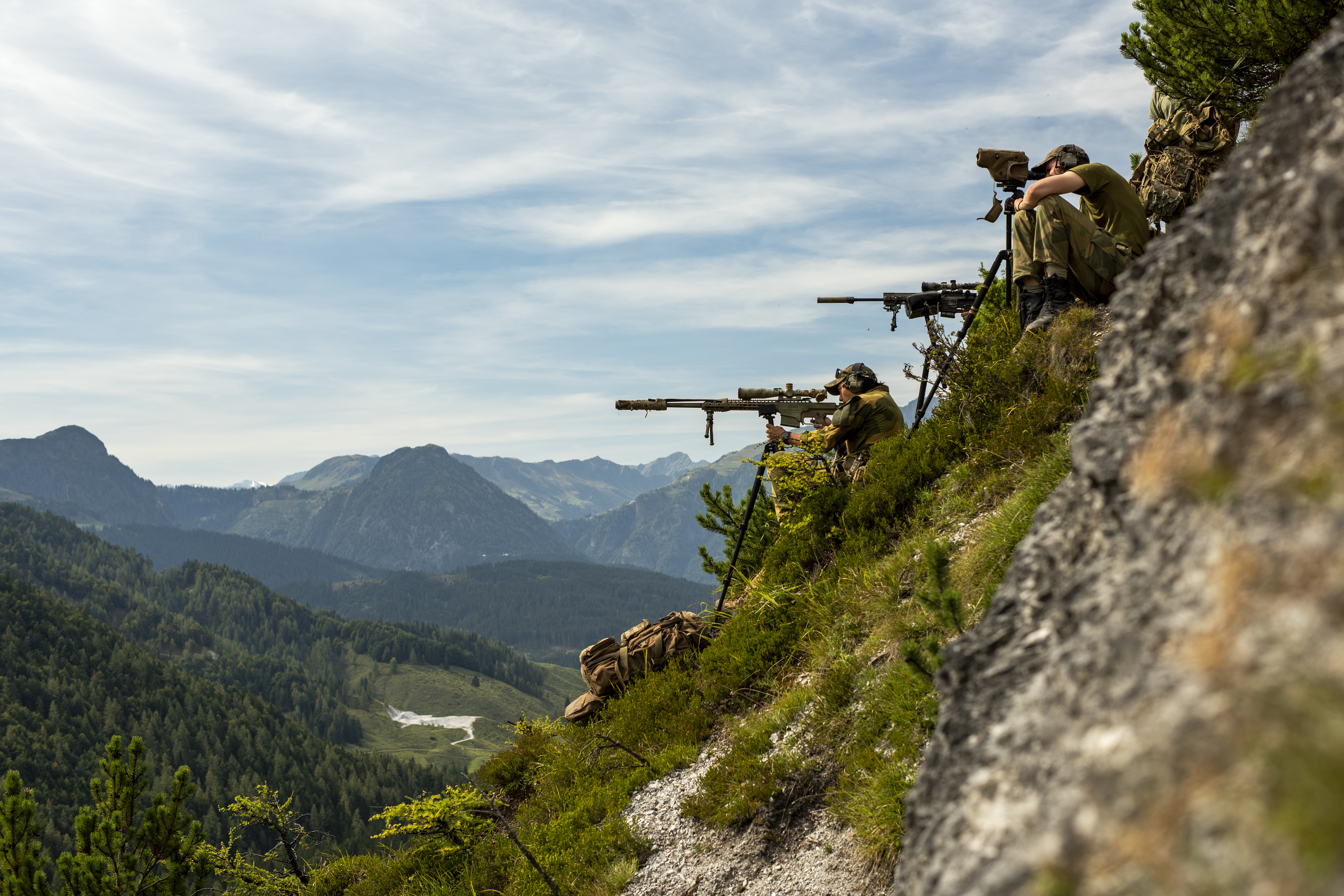 A Norwegian Army Telemark Battalion sniper team takes aim at targets across a valley on Sept. 11, 2018 during the International Special Training Centre High-Angle/Urban Course at the Hochfilzen Training Area, Austria. The high-angle portion of the two-week course is designed to teach trained sniper teams the necessary skills operating in mountainous terrain. (U.S. Army photo by 1st Lt. Benjamin Haulenbeek)
