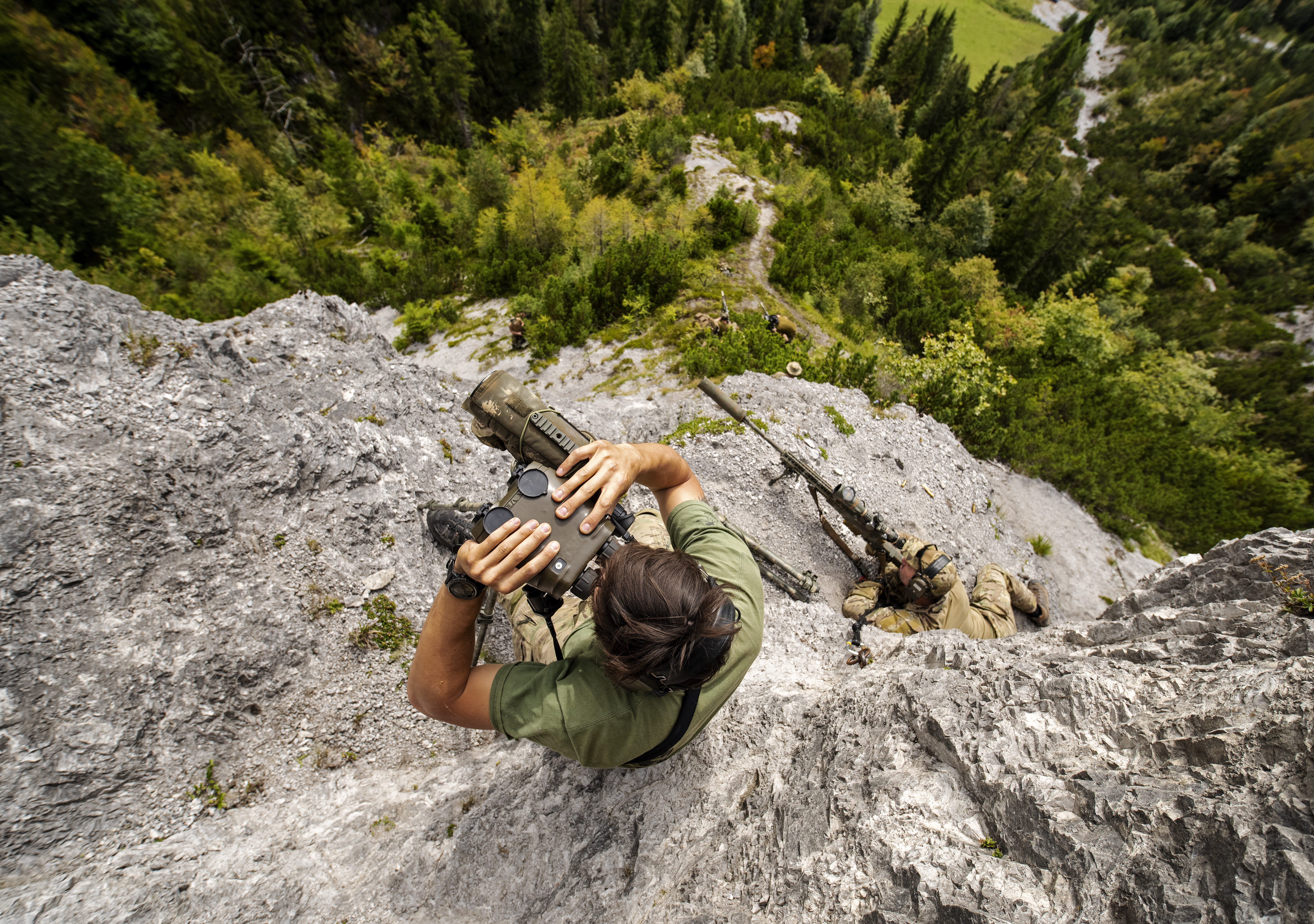 A Belgian Special Forces sniper team identifies targets 2000 meters away, across a valley on Sept. 11, 2018 during the International Special Training Centre High-Angle/Urban Course at the Hochfilzen Training Area, Austria. The high-angle portion of the two-week course is designed to teach trained sniper teams the necessary skills operating in mountainous terrain. (U.S. Army photo by 1st Lt. Benjamin Haulenbeek)