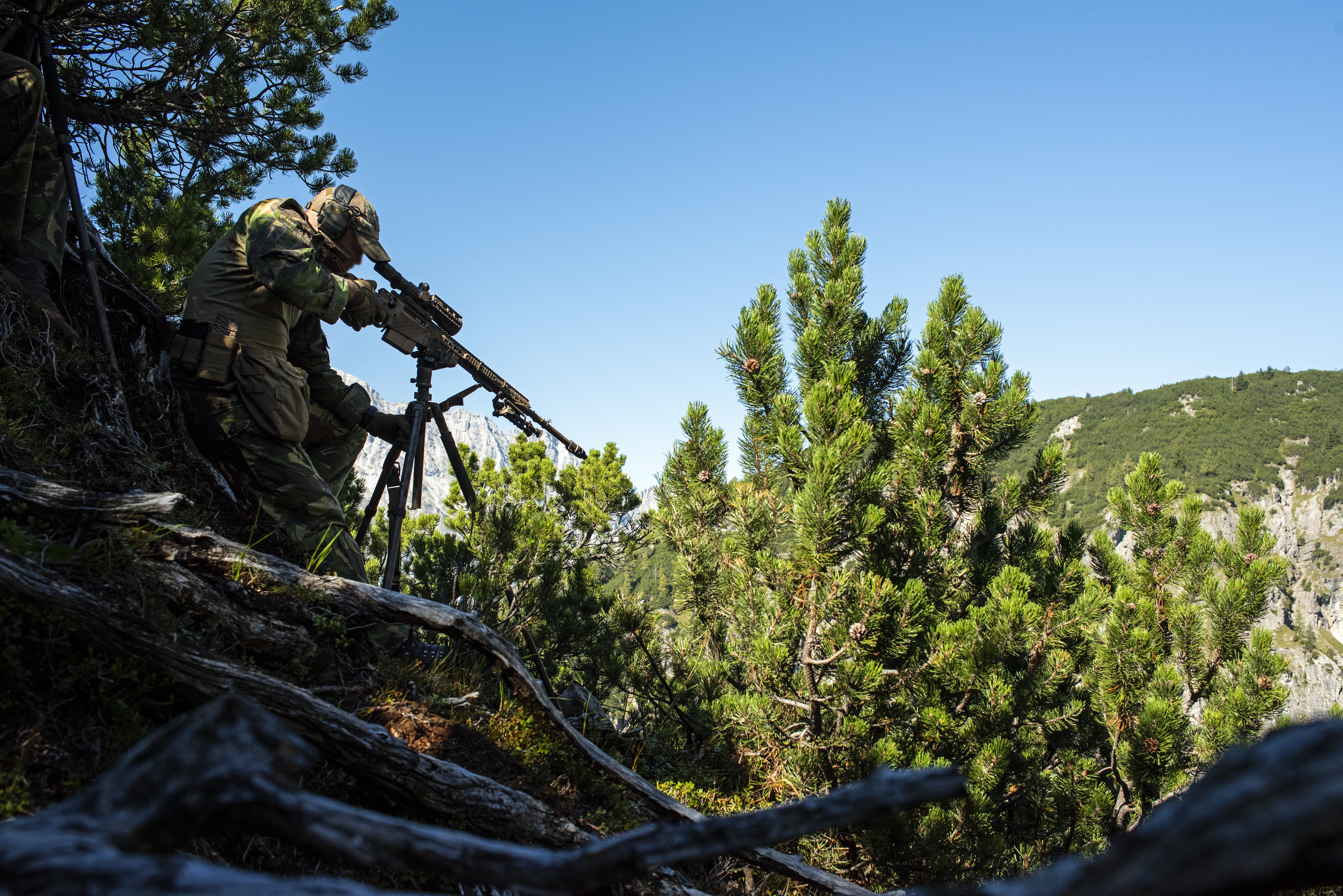 A Dutch sniper engages targets in a valley below on Sept. 12, 2018 during the International Special Training Centre High-Angle/Urban Course at the Hochfilzen Training Area, Austria. The high-angle portion of the two-week course is designed to teach trained sniper teams the necessary skills operating in mountainous terrain. (U.S. Army photo by 1st Lt. Benjamin Haulenbeek)