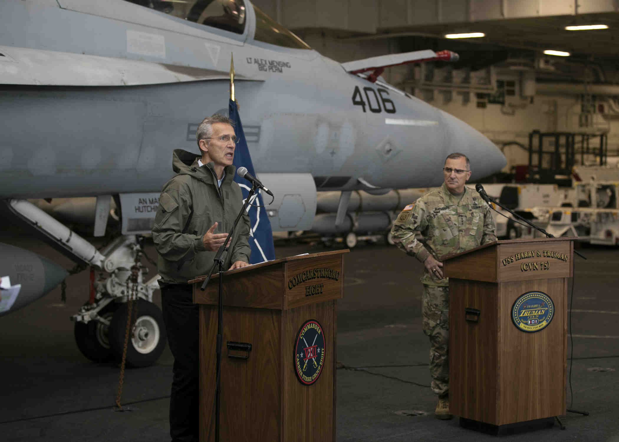 181012-N-XS424-0228 NORTH SEA (Oct. 12, 2018) NATO Secretary General Jens Stoltenburg, left, and Supreme Allied Commander Europe, Gen. Mike Scaparrotti speak at a press conference in the hangar bay aboard the Nimitz-class aircraft carrier USS Harry S. Truman (CVN 75). Currently operating in the U.S. Sixth Fleet area of operations, Harry S. Truman will continue to foster cooperation with regional allies and partners, strengthen regional stability, and remain vigilant, agile and dynamic. (U.S. Navy photo by Mass Communication Specialist 3rd Class Sean Elliott/Released)
