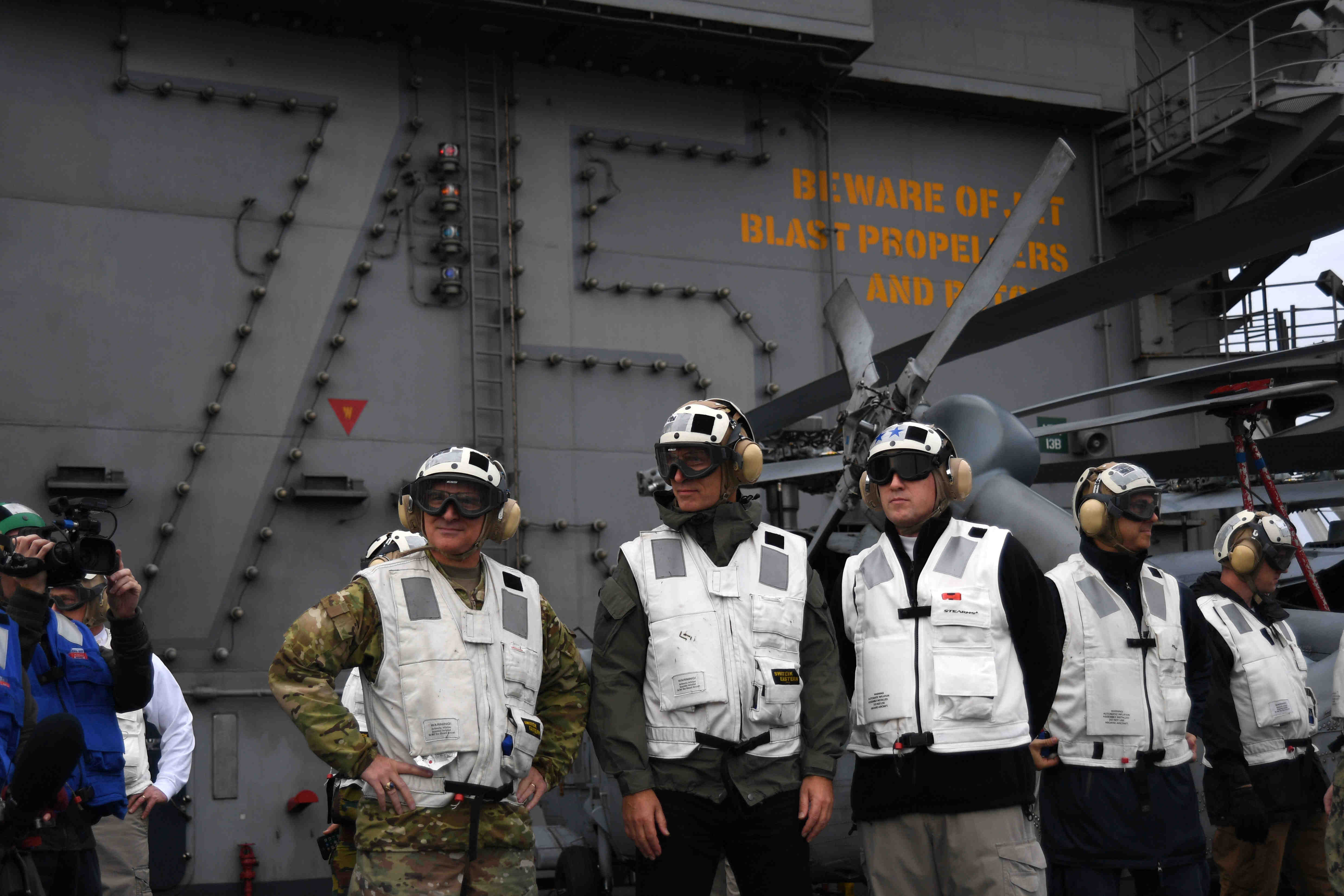 181012-N-EA818-0464 NORTH SEA (Oct. 12, 2018) NATO Secretary General Jens Stoltenburg, center, Supreme Allied Commander Europe, Gen. Mike Scaparotti, left, and Commander, Carrier Strike Group 8, Rear Adm. Gene Black observe flight operations on the flight deck aboard the Nimitz-class aircraft carrier USS Harry S. Truman (CVN 75). Currently operating in the U.S. Sixth Fleet area of operations, Harry S. Truman will continue to foster cooperation with regional allies and partners, strengthen regional stability, and remain vigilant, agile and dynamic. (U.S. Navy photo by Mass Communication Specialist 2nd Class Thomas Gooley/Released)