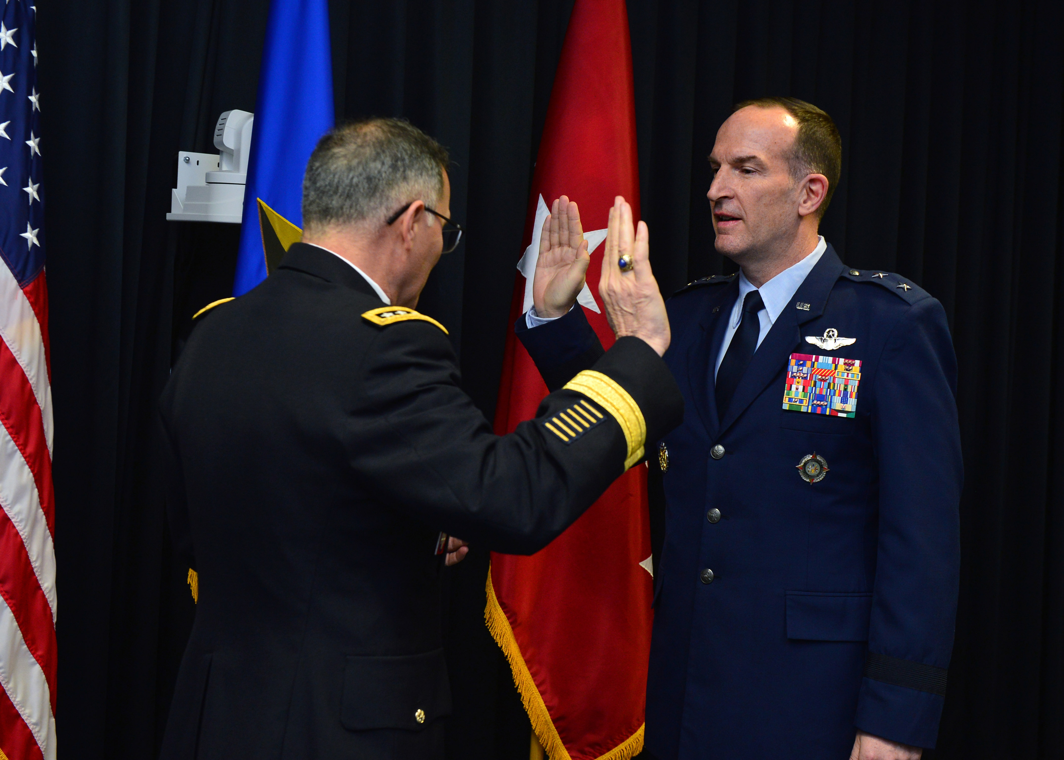 Gen. Curtis M. Scaparrotti, left, U.S. European Command commander, and Brig. Gen. John P. Healy, Director of Exercises and Assessments and Advisor on Reserve Component Affairs for U.S. EUCOM, recite the Oath of Office during Healy's promotion ceremony in Stuttgart, Germany on Dec.14, 2018. Healy was promoted to the rank of major general in the U.S. Air Force.